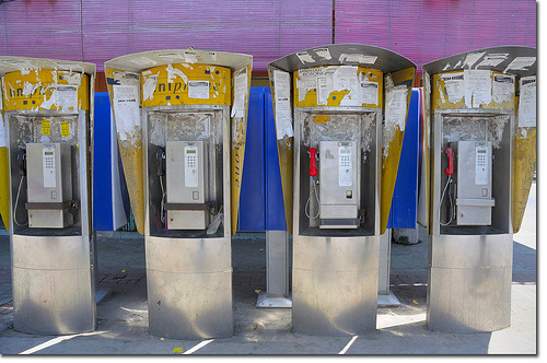 The Iconic Yellow Public Phone Booth
